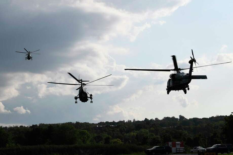 Marine One, left, with President Donald Trump on board, lifts off from Morristown Municipal Airport in Morristown, N.J., Friday, Aug. 9, 2019, for the short trip to Trump's golf club where he will be vacationing for a week. (AP Photo/Susan Walsh) Photo: Susan Walsh / Copyright 2019 The Associated Press. All rights reserved.