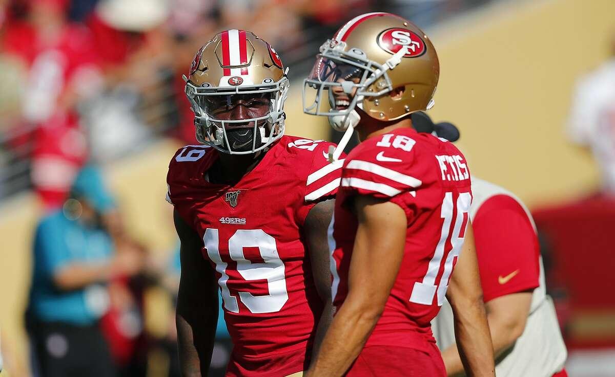 San Francisco 49ers wide receiver Deebo Samuel (19) talks with wide receiver Dante Pettis (18) before an NFL preseason football game against the Dallas Cowboys in Santa Clara, Calif., Saturday, Aug. 10, 2019. (AP Photo/John Hefti)