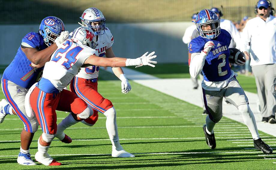 West Brook's Deonte Simpson looks to evade the tackle effort of Doak Wilson Austin Westlake's in the Class 6A state semifinals at Legacy Stadium.  Photo taken Saturday, December 15, 2018  Kim Brent/The Enterprise Photo: Kim Brent / The Enterprise / BEN