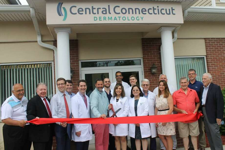 Central Connecticut Dermatology of Cromwell held a grand opening July 18 with dermatologists Drs. Amy Y. Chen, Bruce Strober, Hanspaul Makkar, Justin Finch, Michael Payette, Mona Shahriari and James Whalen, and practice manager Maria Muscatello and their team. They joined Chamber Chairman Don DeVivo, immediate past chairman Jay Polke, Cromwell Division Chair Rodney Bitgood, Chamber President Larry McHugh, Mayor Mayor Enzo Faienza, Town Manager Tony Salvatore, state Sen. Matt Lesser, state Rep. Christie Carpino and other local and business officials for the celebration. Photo: Contributed Photo