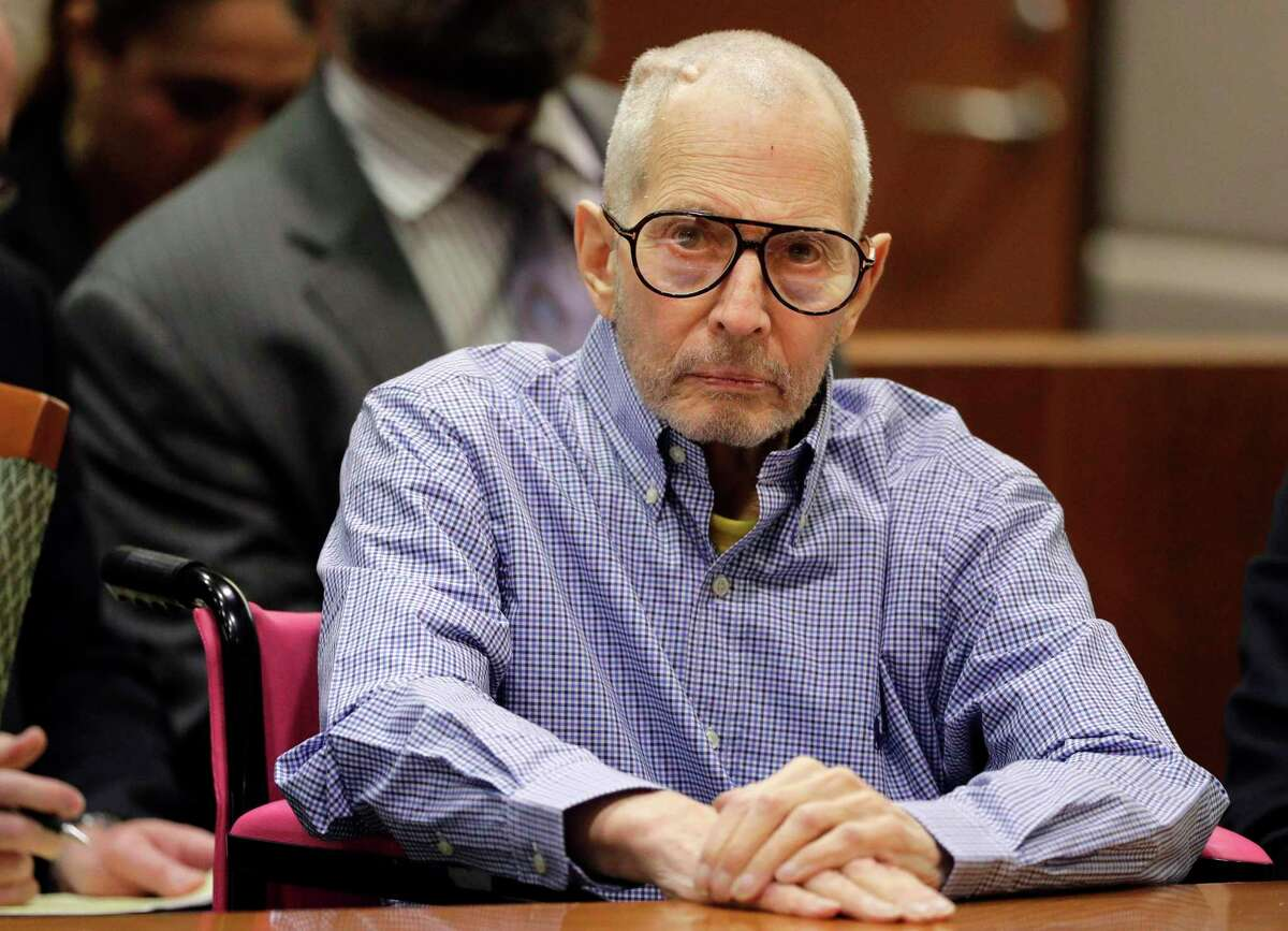 FILE - In this Dec. 21, 2016 file photo, millionaire real estate heir Robert Durst sits in a courtroom in Los Angeles. The preliminary hearing in the murder case against Durst has been delayed until 2018. A Los Angeles judge set an April 16 hearing to determine if Durst will stand trial in the killing of friend his close friend, Susan Berman. The hearing was originally scheduled for October in Los Angeles Superior Court.
