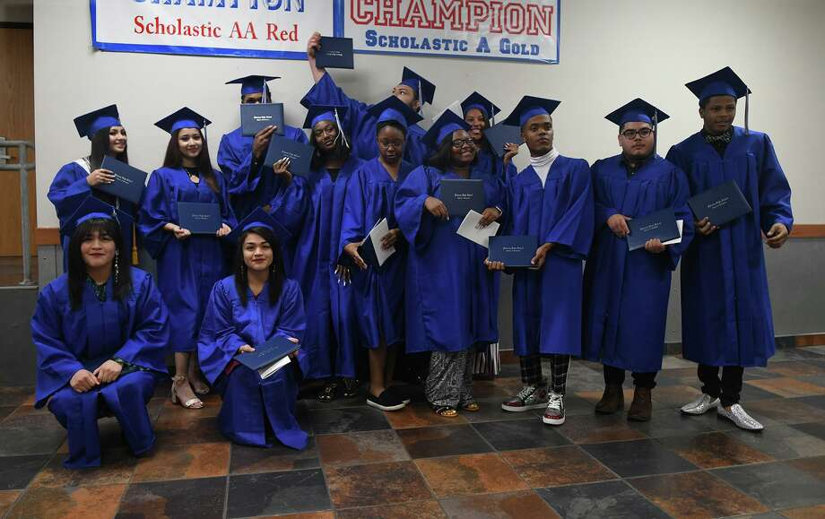 The Dekaney High School Class of 2019 summer graduates pose for a class photo after the Spring Independent School District Summer 2019 Commencement Ceremony in the Star Theater at Dekaney High School on August 10, 2019. Photo: Jerry Baker, Houston Chronicle / Contributor / Houston Chronicle