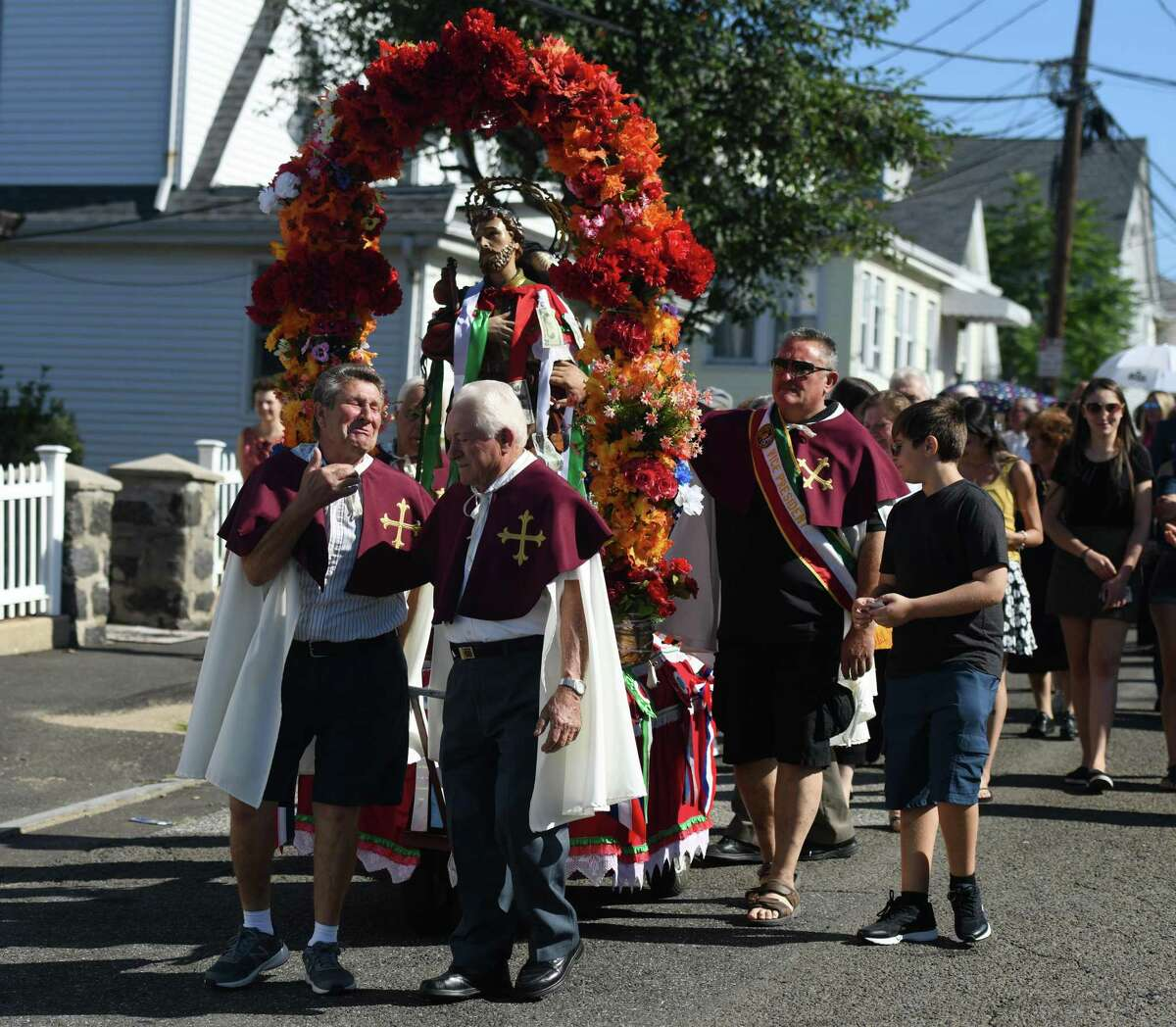 Pietro Pennella, left, of Port Chester, N.Y., and Guiseppe Pennella, of Harrison, N.Y., lead the the 110th annual St. Roch Church procession through the streets in the Chickahominy section of Greenwich, Conn. Sunday, Aug. 11, 2019. To close out the Feast, the church paid tribute to St. Roch with a procession featuring a statue of St. Roch and music from the Dixie Dandies. Onlookers crowded the streets and pinned money to ribbons on the statue as the procession made its way through town.