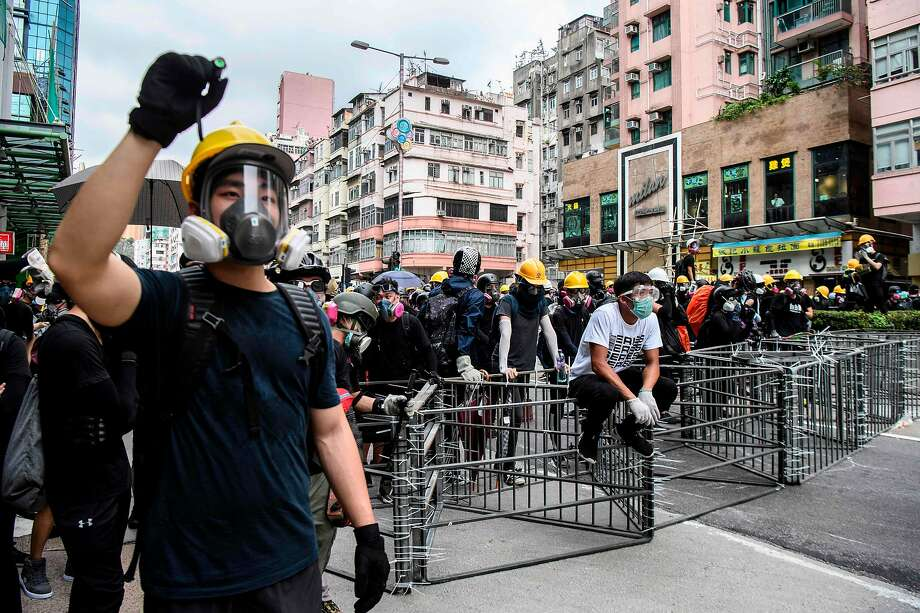 Protesters gather in Sham Shui Po before tear gas was fired, in Hong Kong on August 11, 2019, in the latest opposition to a planned extradition law that was quickly evolved into a wider movement for democratic reforms. - Thousands of pro-democracy protesters hit the streets of Hong Kong for a tenth weekend in-a-row on August 11, again defying police who fired volleys of tear gas at several locations. (Photo by ANTHONY WALLACE / AFP)ANTHONY WALLACE/AFP/Getty Images Photo: ANTHONY WALLACE;Anthony Wallace / AFP / Getty Images
