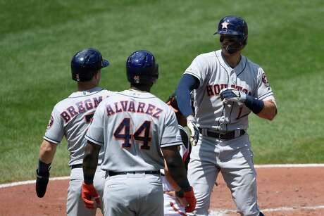 Houston Astros' Carlos Correa, right, celebrates his three-run home run with Alex Bregman, left, and Yordan Alvarez (44) during the second inning of a baseball game against the Baltimore Orioles, Sunday, Aug. 11, 2019, in Baltimore. (AP Photo/Nick Wass)