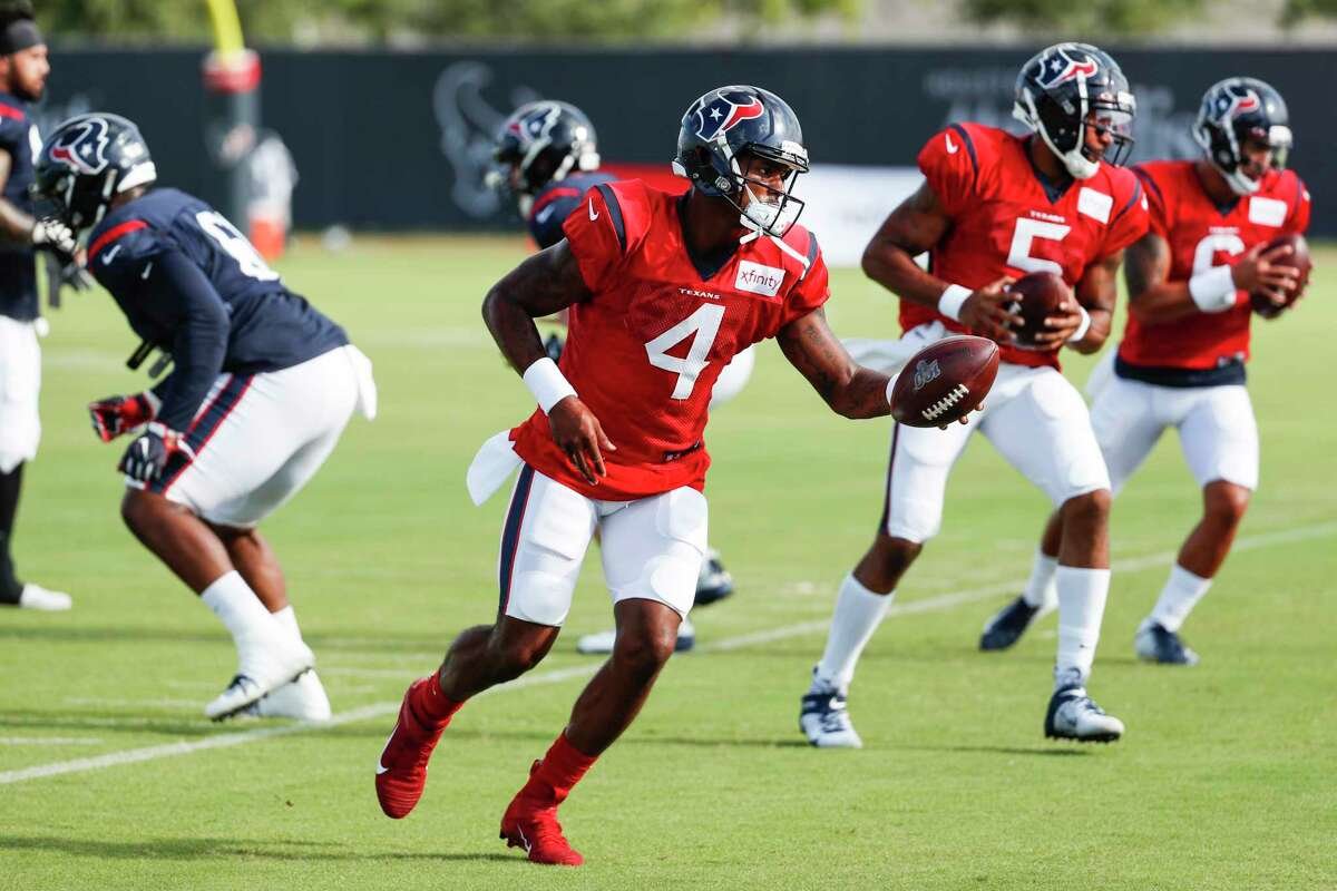 Houston Texans quarterback Deshaun Watson (4) leads a handoff drill during training camp at the Methodist Training Center on Aug. 10, 2019, in Houston.