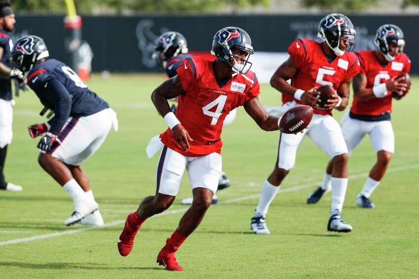Houston Texans quarterback Deshaun Watson (4) leads a handoff drill during training camp at the Methodist Training Center on Aug. 10, 2019, in Houston.
