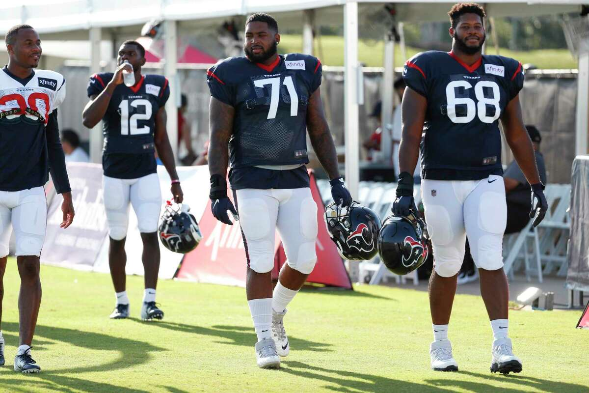 Houston Texans offensive tackle Tytus Howard (71) and guard Malcolm Pridgeon (68) walks onto the practice field during training camp at the Methodist Training Center on Aug. 10, 2019, in Houston.