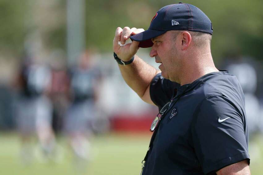 Houston Texans head coach Bill O'Brien walks across the field during training camp at the Methodist Training Center on Aug. 10, 2019, in Houston.