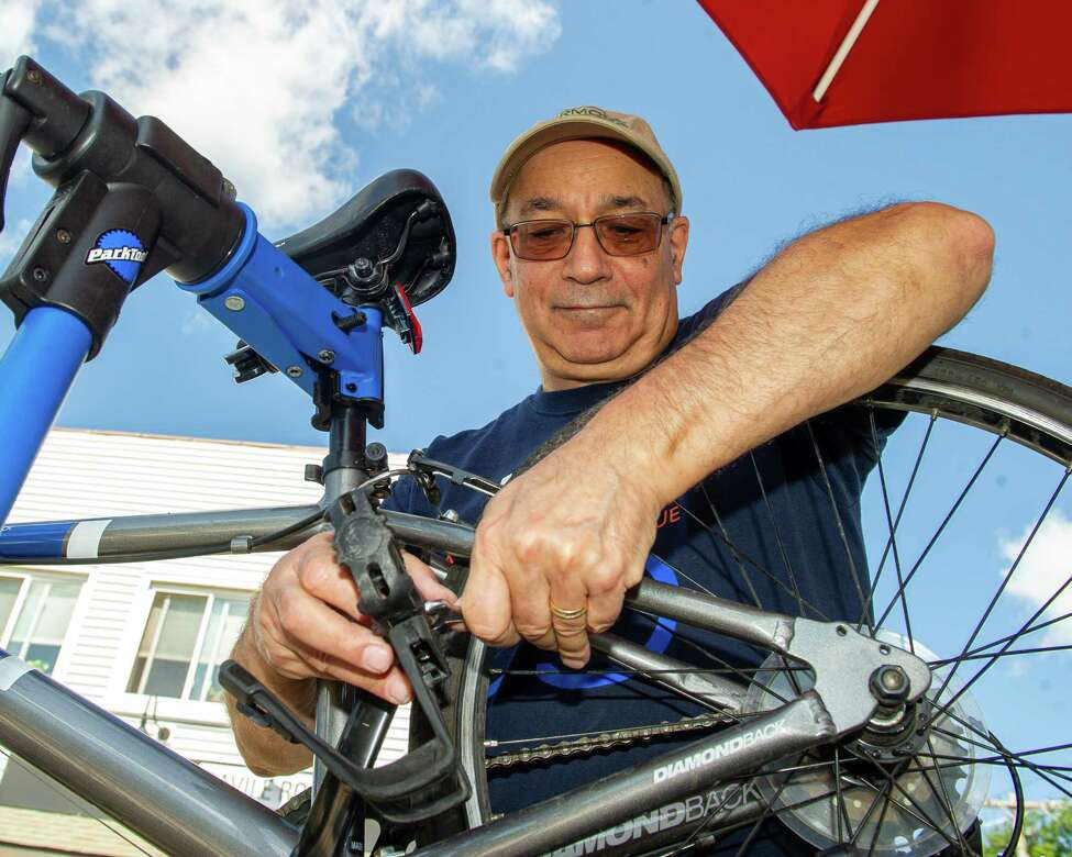 Bruce Herbach, vice chair of the Albany Bike Rescue, works on a bike at an Albany Bike Rescue flea market held at the Savile Road bicycle shop in Delmar NY on Sunday, Aug. 11, 2019 (Jim Franco/Special to the Times Union.)