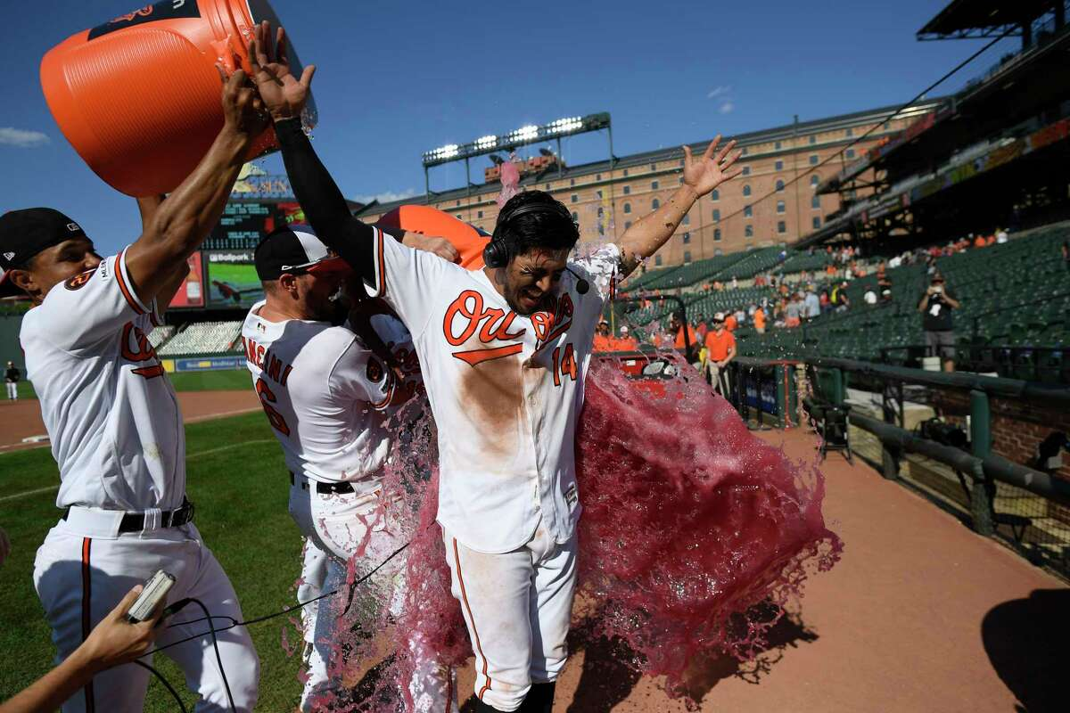 Baltimore Orioles' Rio Ruiz is doused after a baseball game against the Houston Astros, Sunday, Aug. 11, 2019, in Baltimore. Ruiz hit a two-run walkout home run. The Orioles won 8-7. (AP Photo/Nick Wass)