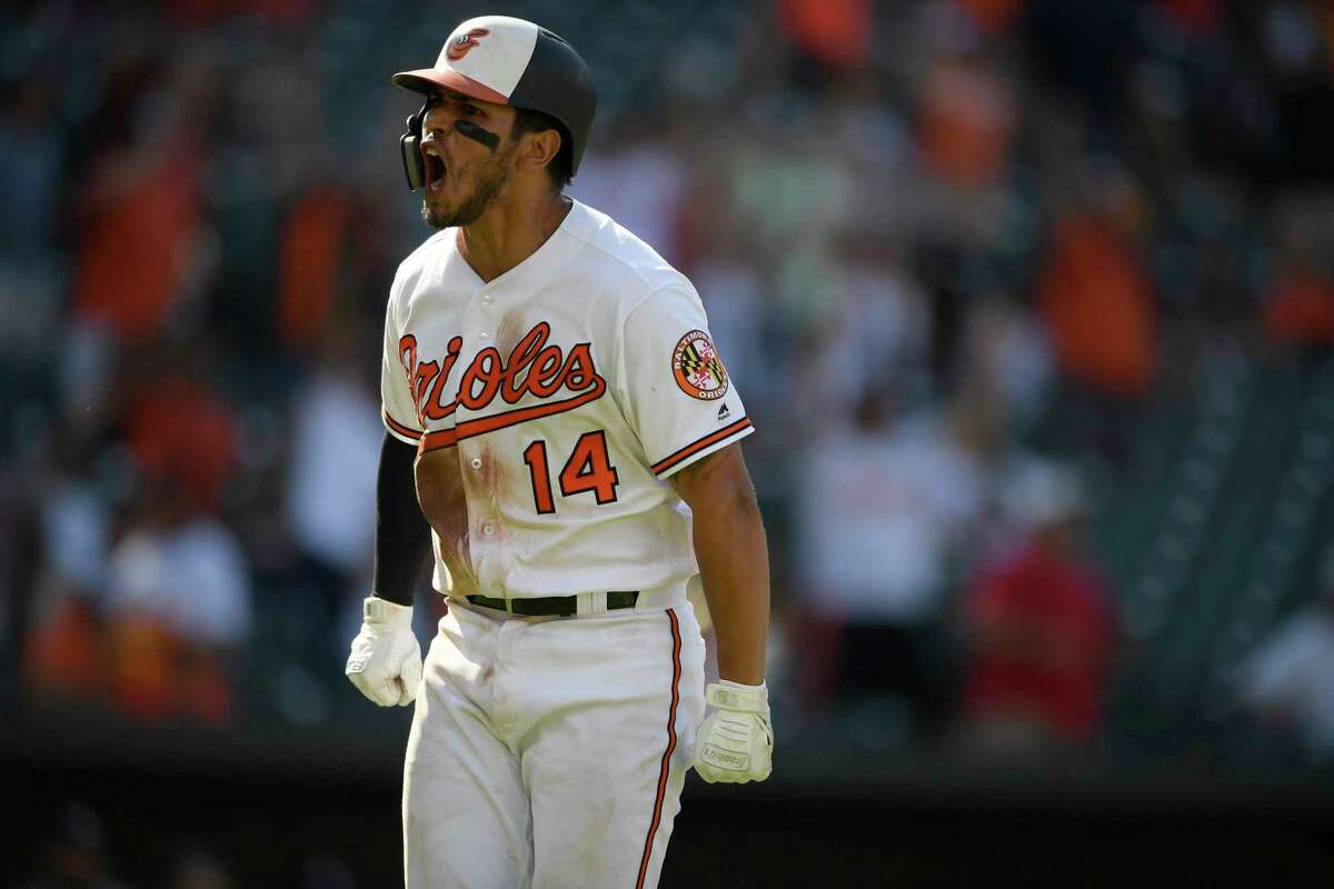 Baltimore Orioles' Rio Ruiz reacts towards the dugout on his way to first to round the bases after he hit a two-run walkoff home run in a baseball game against the Houston Astros, Sunday, Aug. 11, 2019, in Baltimore. The Orioles won 8-7. (AP Photo/Nick Wass)
