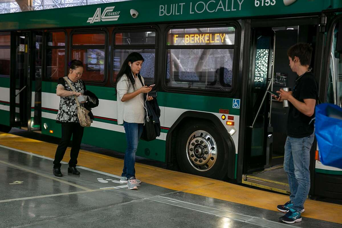 Commuters wait to board a Alameda-Contra Costa Transit (AC Transit) bus at the reopened Salesforce Transit Center Sunday, Aug. 11, 2019, in San Francisco, Calif.