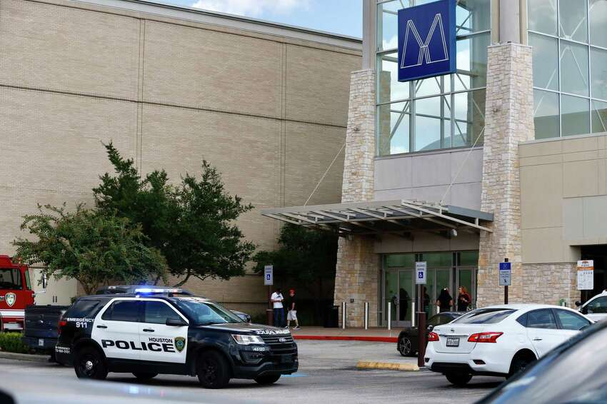 People exit Memorial City Mall where I disturbance cause an evacuation of the shopping center on Sunday, Aug. 11, 2019, in Houston.