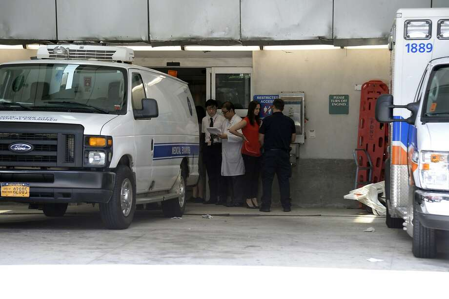 A body believed to be that of Jeffrey Epstein is loaded into a Medical Examiner's van at New York-Presbyterian Hospital, in New York, Aug. 10, 2019. Epstein, the financier who apparently hanged himself in a federal jail in Manhattan, was housed alone in a cell just two weeks after he had been taken off suicide watch and was supposed to have been checked by guards every 30 minutes, but that procedure was not being followed the night before he was found, according to officials. (Jefferson Siegel/The New York Times) Photo: Jefferson Siegel, NYT