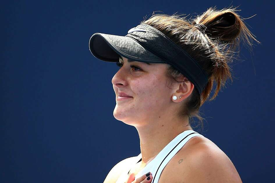 TORONTO, ON - AUGUST 11: Bianca Andreescu of Canada gestures to the crowd following her victory over Serena Williams of the United States in the final match on Day 9 of the Rogers Cup at Aviva Centre on August 11, 2019 in Toronto, Canada. Williams withdrew from the match with a back injury. (Photo by Vaughn Ridley/Getty Images)