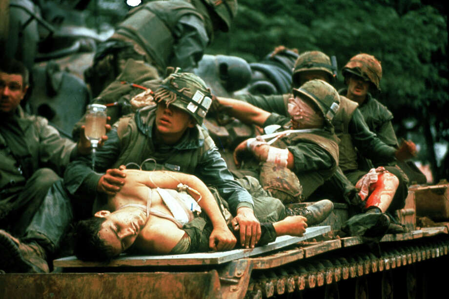 Wounded Marines are atop a tank as they are being evacuated from the Battle of Hue during the Tet Offensive in South Vietnam in 1968. (Spec. 4 John Olson / Stars and Stripes 1968)