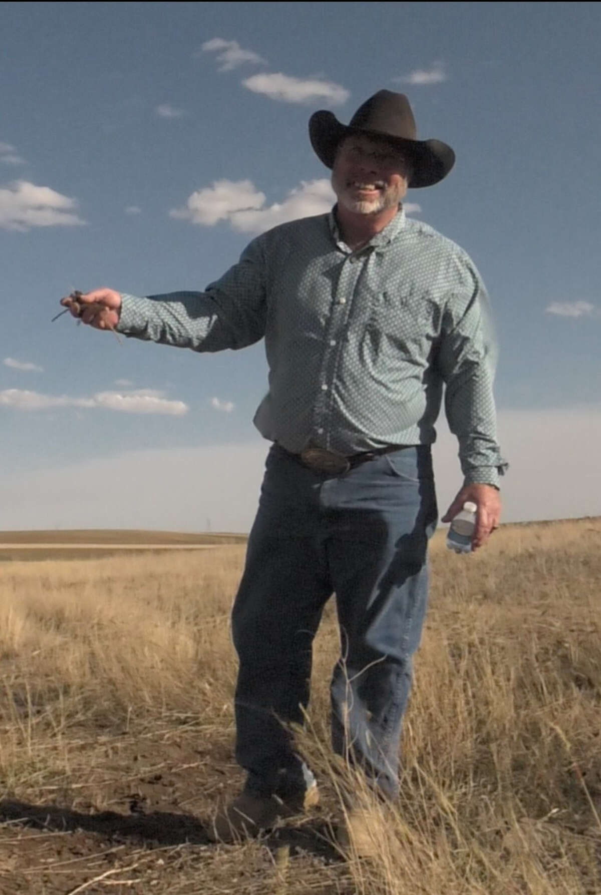 Marvin Nash, general manager, Encore Green Environmental, visits the company's pilot program using its Conservation-By-Design method on farm acreage in Wyoming.