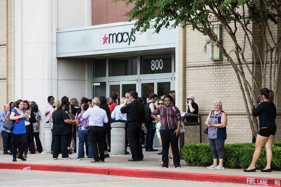 People stand outside Memorial City Mall where a disturbance forced an evacuation of the shopping center on Sunday, Aug. 11, 2019, in Houston. Photo: Brett Coomer, Staff Photographer / © 2019 Houston Chronicle