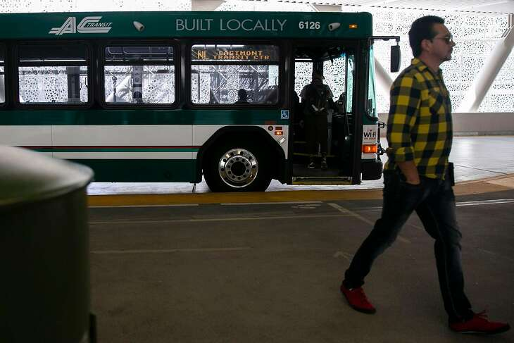 A commuter leaves an Alameda-Contra Costa Transit bus after it pulled into the Salesforce Transit Center on the first day AC Transit service returns to the reopened Salesforce Transit Center Sunday, Aug. 11, 2019, in San Francisco, Calif.