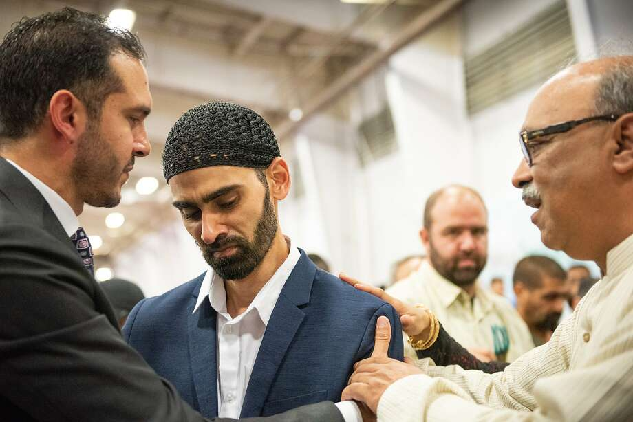 Hamid Hayat (center) meets with community members, including Basim Elkarra (left) of the Council on American-Islamic Relations. Photo: Steve German / Special To The Chronicle