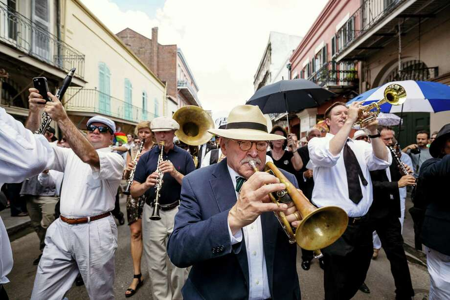 Jim Cullum plays in the second line after the the funeral for Pete Fountain, a jazz clarinet legend, in New Orleans in 2016. Photo: Contributor File Photo / © Bryan Tarnowski