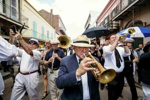 Jim Cullum plays in the second line after the the funeral for Pete Fountain, a jazz clarinet legend, in New Orleans in 2016.