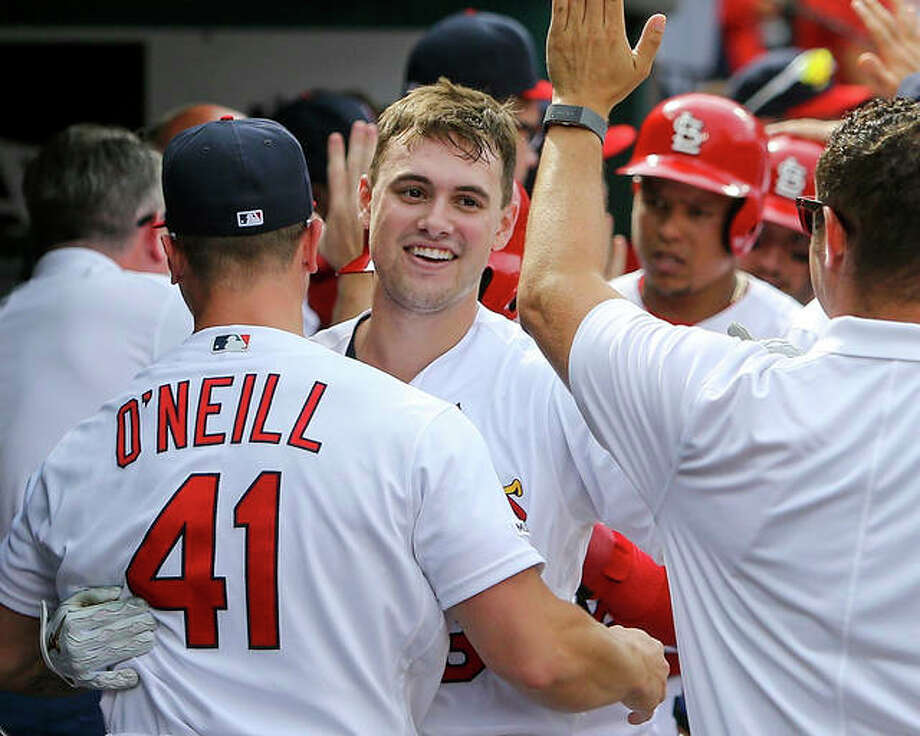 The Cardinals' Lane Thomas (center) is congratulated by teammates in the dugout after hitting a grand slam during the seventh inning against the Pittsburgh Pirates on Sunday at Busch Stadium. Photo: Scott Kane / Associated Press