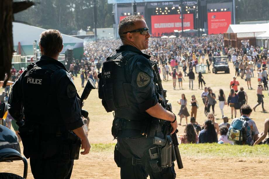 Members of the San Francisco Police Department's SWAT team monitor the crowd in the soccer field at Outside Lands on Sunday. Photo: Paul Kuroda / Special To The Chronicle