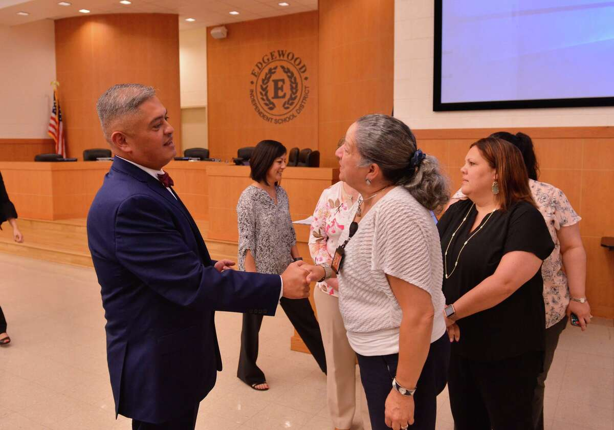 In this file photo, then-incoming Edgewood ISD Superintendent Eduardo Hernandez greets well-wishers during the executive session of a board meeting. Edgewood has been under a state-appointed board of managers since 2017.