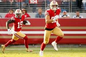 San Francisco 49ers wide receiver Deebo Samuel (19) runs for a gain against the Dallas Cowboys during an NFL preseason game at Levi's Stadium on Saturday, Aug. 10, 2019, in Santa Clara, Calif.