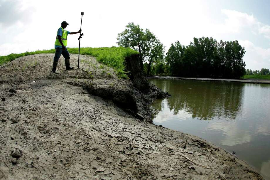 In this Tuesday, Aug. 6, 2019 photo, U.S. Army Corps of Engineers worker Ron Allen uses a GPS tool to survey the extent of damage where a levee failed along the Missouri River near Saline City, Mo. Efforts to fight rising waters may turn out to be only down payments on what is shaping up as a long-term battle against floods, which are forecast to become more frequent and destructive as global temperatures rise. (AP Photo/Charlie Riedel) Photo: Charlie Riedel / Copyright 2019 The Associated Press. All rights reserved.