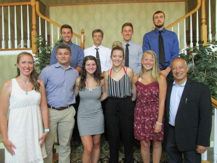 Officers and scholarship recipients attending Sunday's Torrington Varsity Alumni Club annual banquet are, front row, from left, Vice President Christine Gamari, Michael Ivain, Alyssa Maraia, Alyssa Dowd, Alyssa Kreuzer and President Mario Longobucco. Back row, from left, Ben Richardson, Victor Nemesvari, Brett Stater and Kevin Dixon. Photo: Peter Wallace / For Hearst Connecticut Media