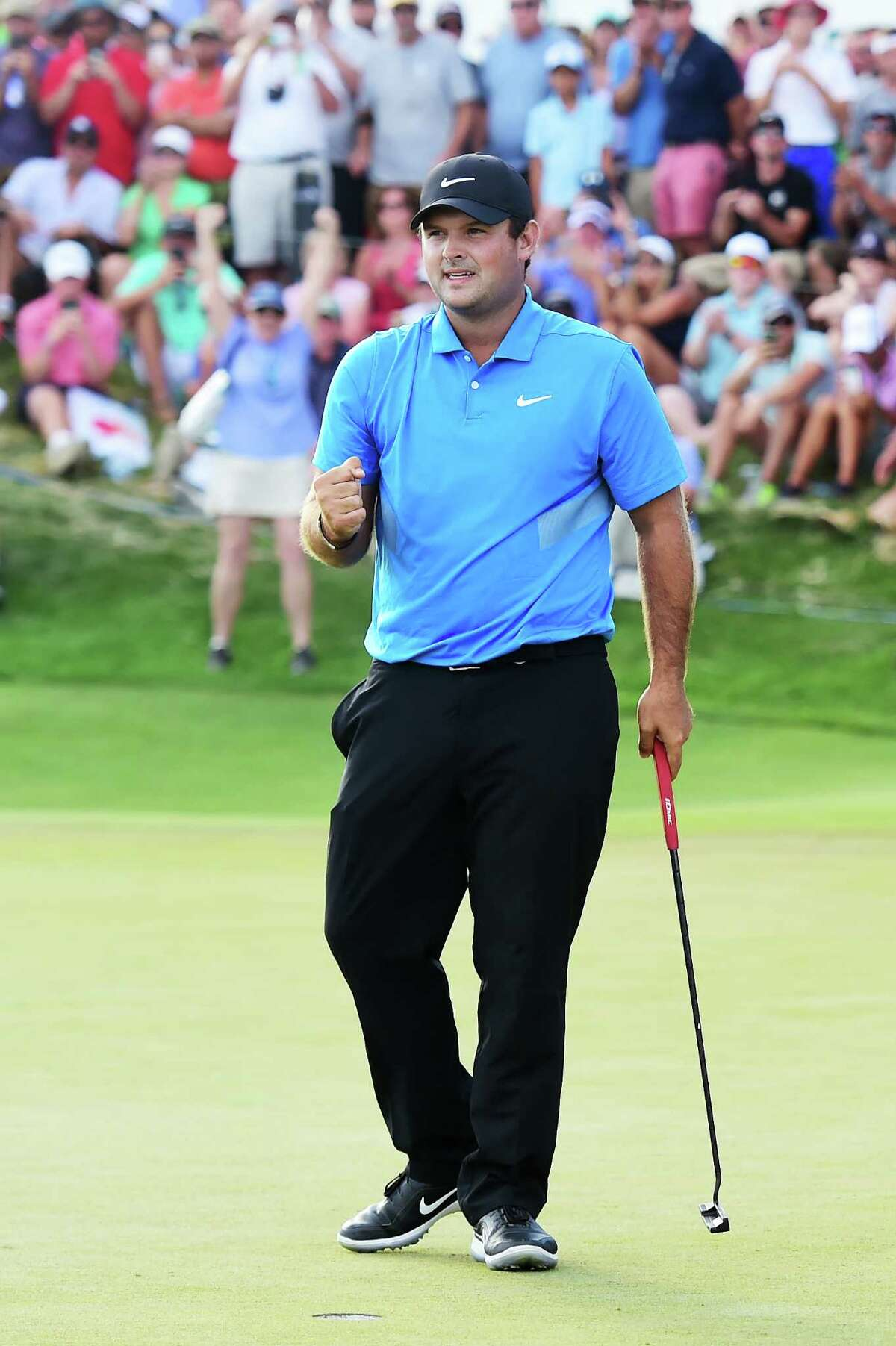 JERSEY CITY, NEW JERSEY - AUGUST 11: Patrick Reed of the United States celebrates on the 18th green after winning during the final round of The Northern Trust at Liberty National Golf Club on August 11, 2019 in Jersey City, New Jersey. (Photo by Jared C. Tilton/Getty Images)