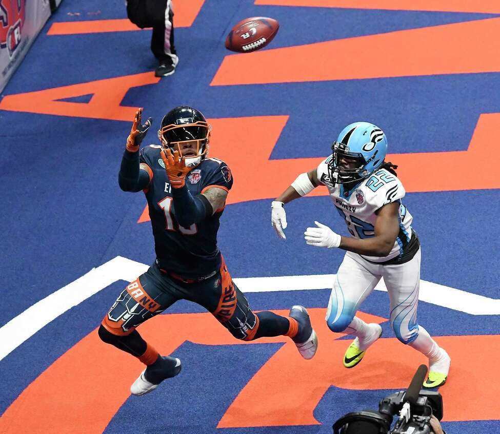 Albany Empire's Quentin Sims (18) makes a catch for touchdown in front of Philadelphia Souls' Dwayne Hollis (22) (22)during the ArenaBowl XXXII football game at the Times Union Center, Sunday, Aug. 11, 2019, in Albany, N.Y.