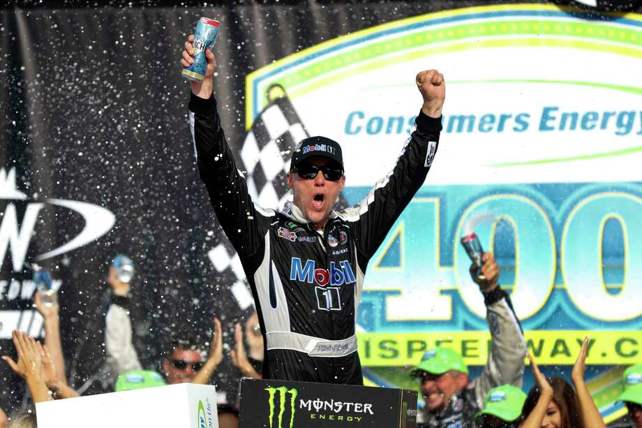 Kevin Harvick celebrates after winning a NASCAR Cup Series auto race at Michigan International Speedway in Brooklyn, Mich., Sunday, Aug. 11, 2019. (AP Photo/Paul Sancya) Photo: Paul Sancya / Copyright 2019 The Associated Press. All rights reserved