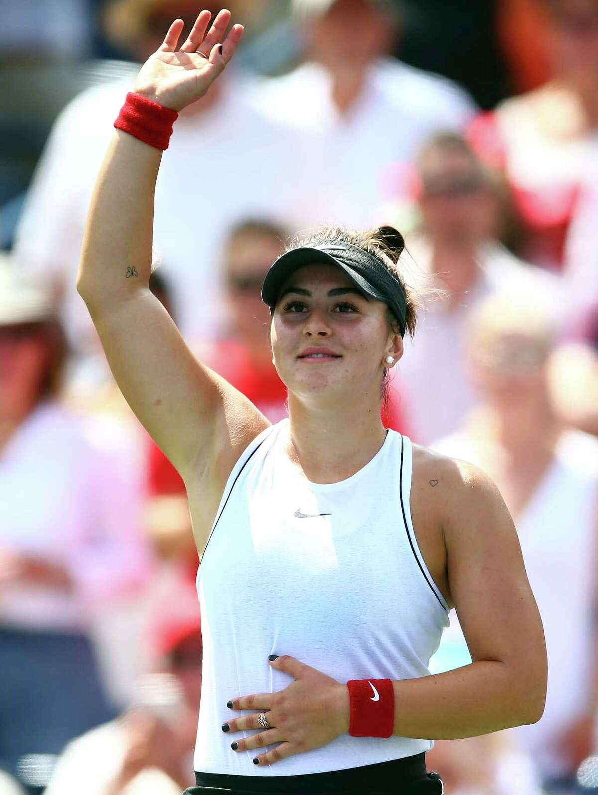 TORONTO, ON - AUGUST 11: Bianca Andreescu of Canada waves to the crowd following her victory over Serena Williams of the United States in the final match on Day 9 of the Rogers Cup at Aviva Centre on August 11, 2019 in Toronto, Canada. Williams withdrew from the match with a back injury. (Photo by Vaughn Ridley/Getty Images)