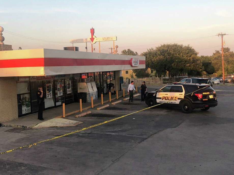 Police investigate a shooting Sunday evening near Jay's Way Food Mart in the 1900 block of Bandera Road on the West Side. Photo: Emilie Eaton /Staff Photographer