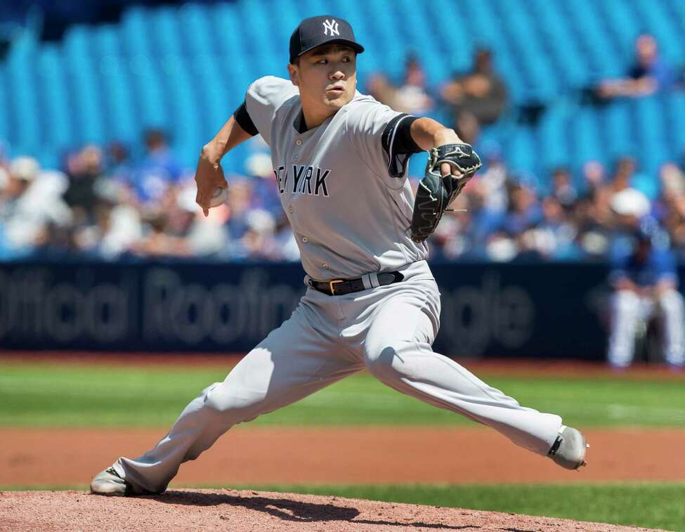 New York Yankees starting pitcher Masahiro Tanaka throws against the Toronto Blue Jays during the first inning of a baseball game in Toronto, Sunday, Aug. 11, 2019. (Fred Thornhill/The Canadian Press via AP)