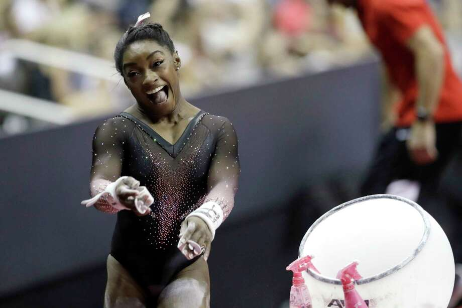 Simone Biles celebrates after competing in the uneven bars to win the all around senior women's competition at the 2019 U.S. Gymnastics Championships Sunday, Aug. 11, 2019, in Kansas City, Mo. (AP Photo/Charlie Riedel) Photo: Charlie Riedel / Copyright 2019 The Associated Press. All rights reserved.