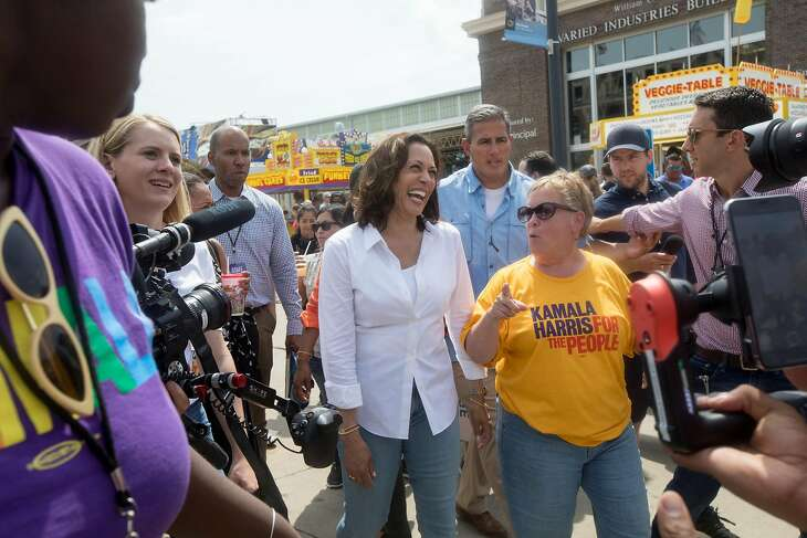Democratic presidential candidate Sen. Kamala Harris walks with Sue Dvorsky at the Iowa State Fair in Des Moines on Saturday, Aug. 10, 2019.