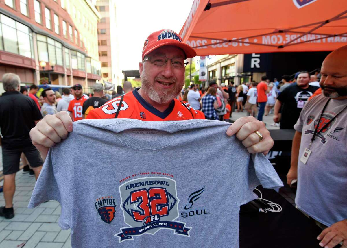 Georged Shuhart of Rensselaer, N.Y. displays a souvenir T-Shirt before the start of the ArenaBowl XXXII football game at the Times Union Center, Sunday, Aug. 11, 2019, in Albany, N.Y. (Hans Pennink / Special to the Times Union)