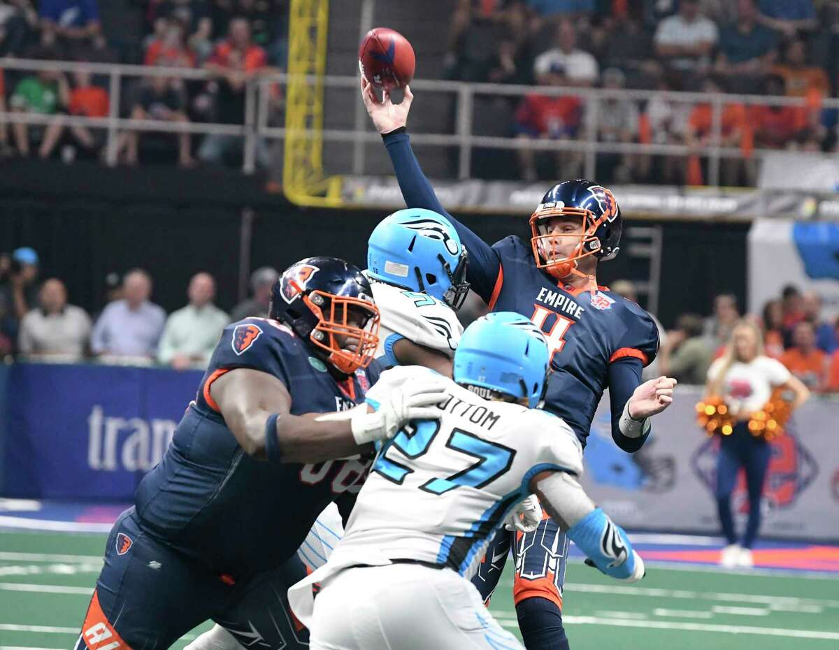 Albany Empire's Tommy Grady (4) throws under pressure by the Philadelphia Souls during the second half of the ArenaBowl XXXII football game at the Times Union Center, Sunday, Aug. 11, 2019, in Albany, N.Y. Albany Empire won 45-27. Grady is returning to the Empire, who are playing in the National Arena League. (Hans Pennink / Special to the Times Union)
