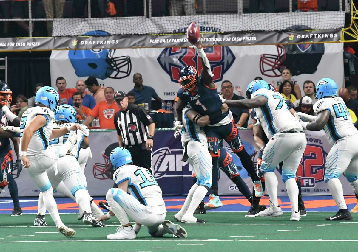 Albany Empire's Joe Sykes (1) blocks a Philadelphia Souls point after kick during the second half of the ArenaBowl XXXII football game at the Times Union Center, Sunday, Aug. 11, 2019, in Albany, N.Y. Albany Empire won 45-27. (Hans Pennink / Special to the Times Union)