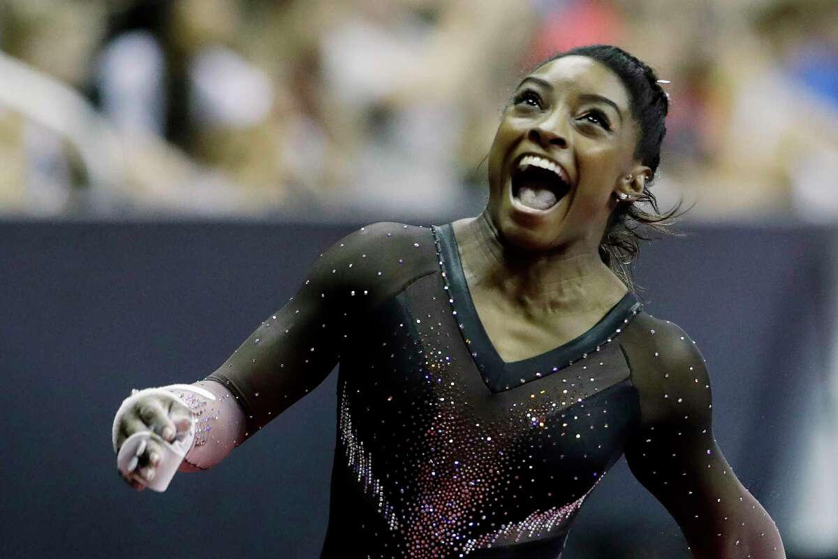 En route to her sixth all-around U.S. gymastics title, Simone Biles won vault, balance beam and floor exercise and finished third on uneven bars.