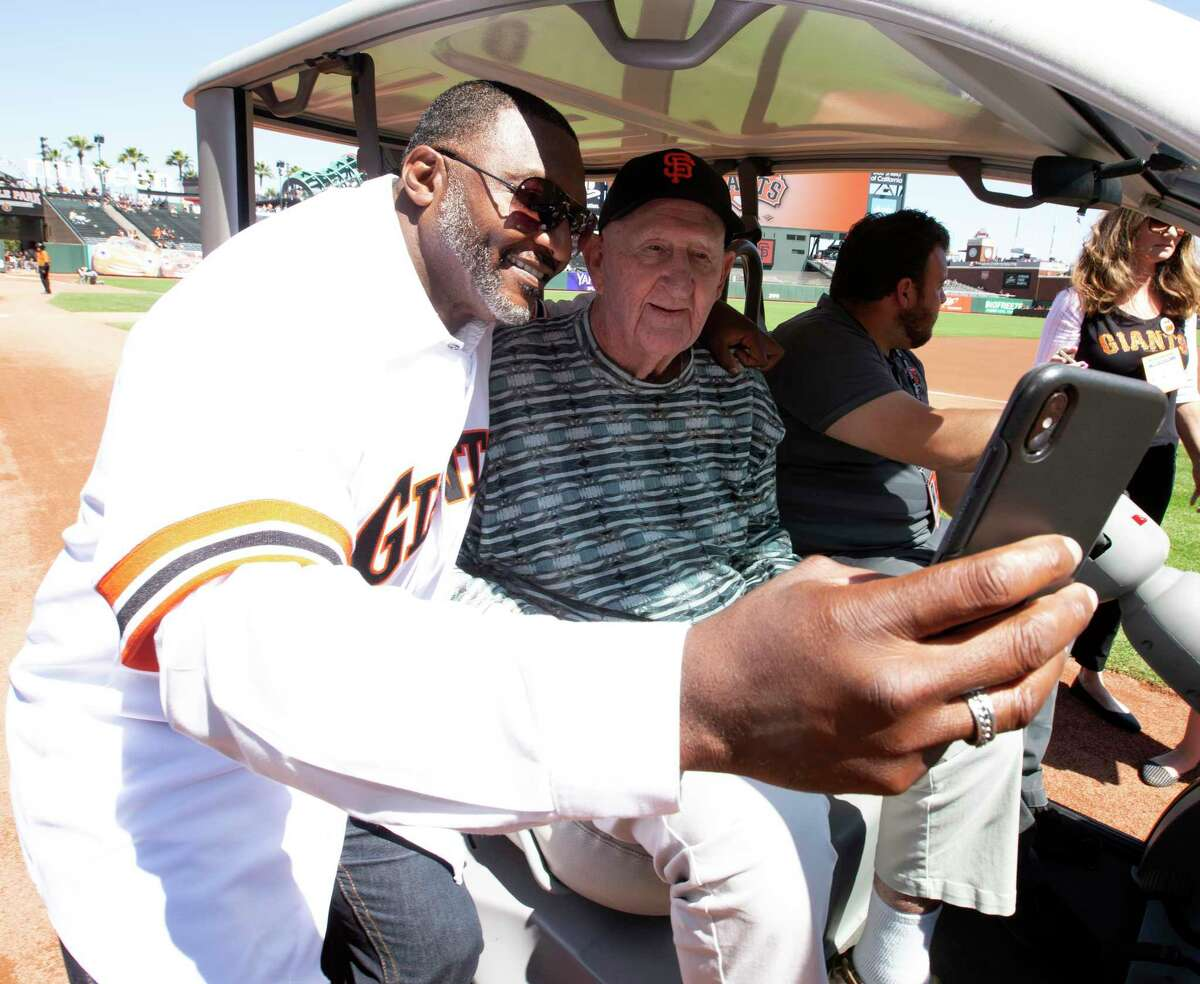 Donell Nixon, left, shoots a selfie with manager Roger Craig before a pregame ceremony honoring the San Francisco Giants 1989 pennant winning team on Sunday, Aug. 11, 2019 in San Francisco, Calif.