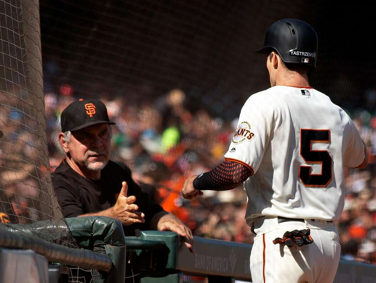 San Francisco Giants manager Bruce Bochy, left, greets Mike Yastrzemski (5) after he hit a solo home run against the Philadelphia Phillies during the third inning of a Major League Baseball game Sunday, Aug. 11, 2019 in San Francisco, Calif.