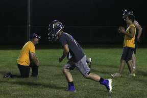The North Huron varsity football team held its first practice of the 2019 season at 12:01 a.m. Monday.