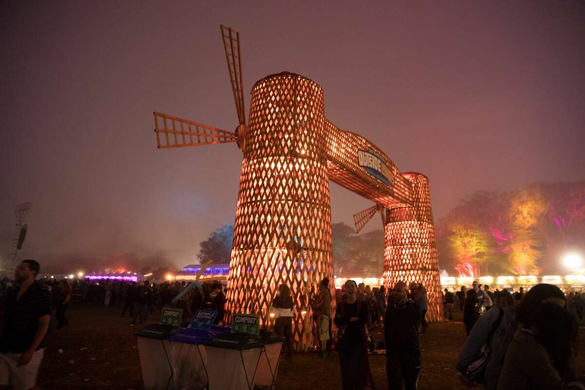 The windmills are lit up at night at the 2019 Outside Lands in Golden Gate Park in San Francisco, Calif. on August 10, 2019.