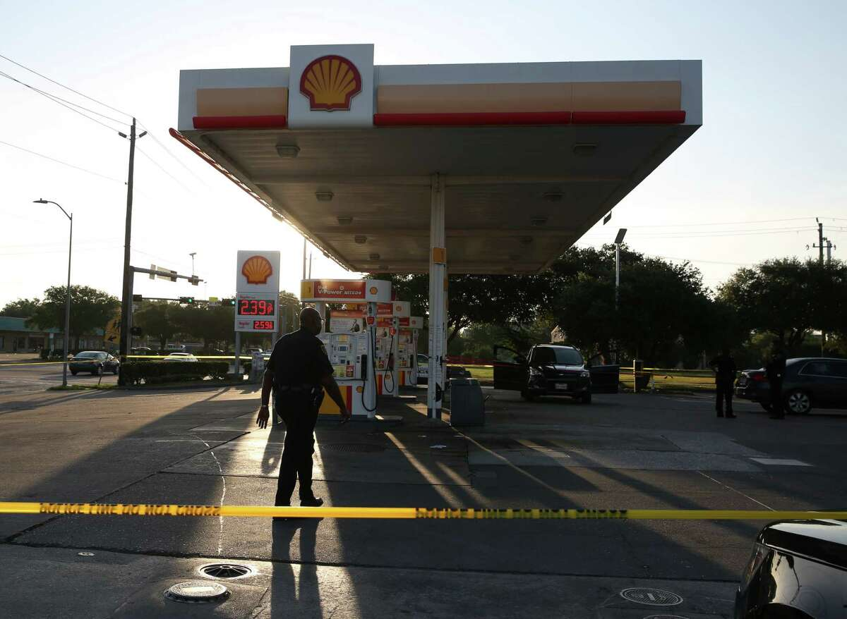 HPD officers respond to 7100 block of West Fuqua Street, where two people were shot and one person deceased at a gas station, on Monday, Aug. 12, in Houston.